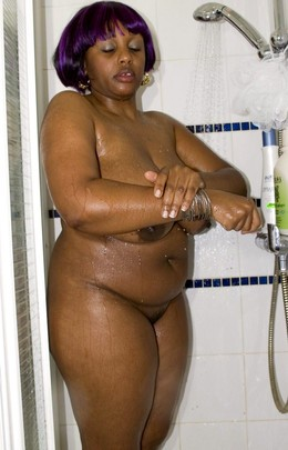 Horny ebony BBW washes her big tits in..