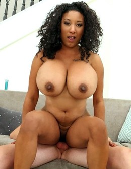 Black chick with incredibly huge boobs..
